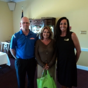 John Dotson & Tracy Miller of SewPro award student Cheryl Fuller the door prize