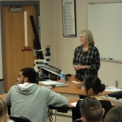 Ms. Hill addresses RMI students in a class setting