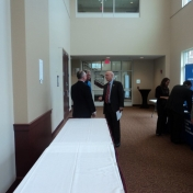 Dr. Rogow visits with Jimmy Blount and other industry professionals.