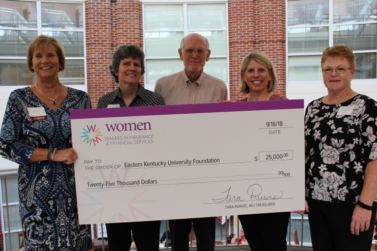 Women Leaders in Insurance presents scholarship check to EKU RMI
